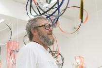 "Tobias Rehberger during the installation of ""Wrap It Up"" at the MACRO, September 2014. Photo Giorgio Benni"